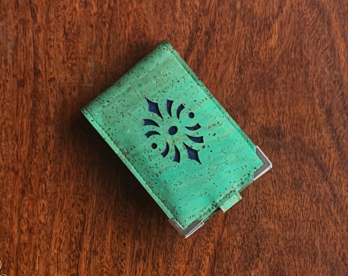 Mini card wallet made from vegan pale green cork fabric/cork leather enhanced with a geometric design backed in blue cork leather