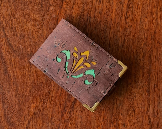 Mini card wallet made from vegan chocolate brown cork fabric/cork leather enhanced with a laser cut art nouveau lily backed in coloured cork