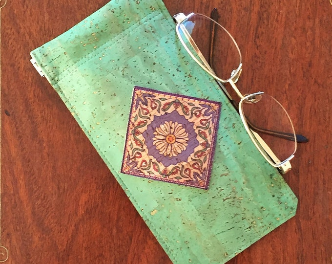 Green cork leather/cork fabric spectacles/glasses case with a geometric cork leather print appliqué and a squeezy spring closure - vegan