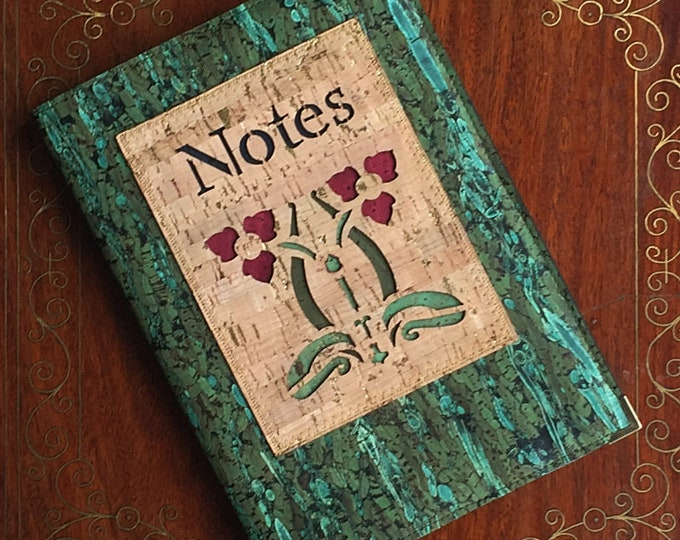 Vegan green cork and fennel leather notebook enhanced with an appliqué  of two art nouveau triangular poppies backed with coloured cork