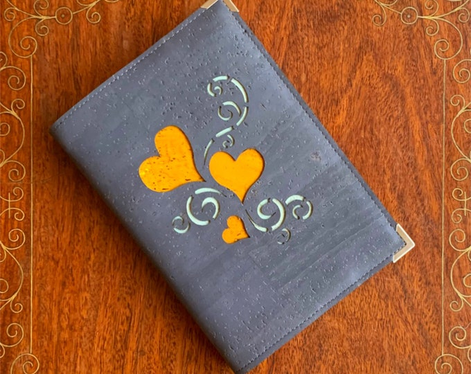 Hearts of gold A6 notebook covered in grey cork fabric/cork leather  -  3 laser cut hearts and tendrils backed with yellow and aqua cork