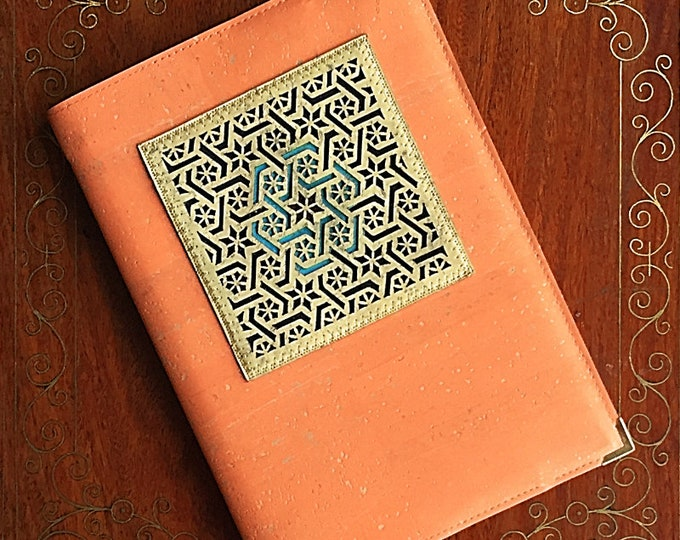 Vegan peach cork leather/cork fabric covered plain paper notebook with a fawn appliqué cut into a trellis design backed in coloured cork