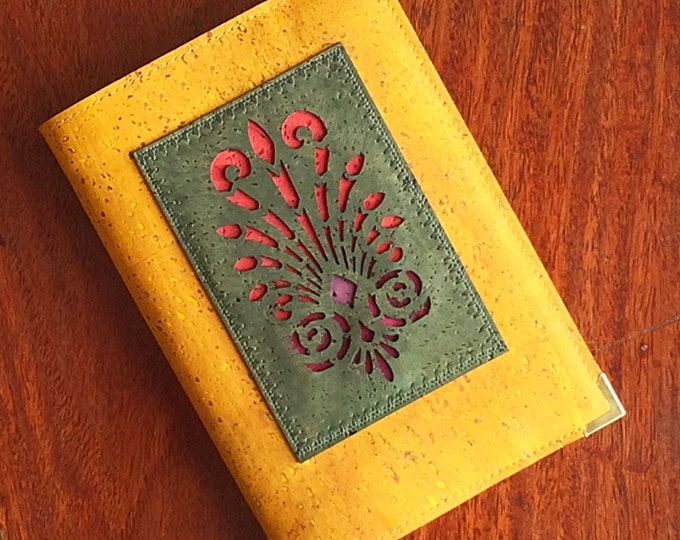 Vegan mustard yellow A6 cork leather/fabric notebook with an olive green appliqué of an organic, geometric design backed in coloured cork