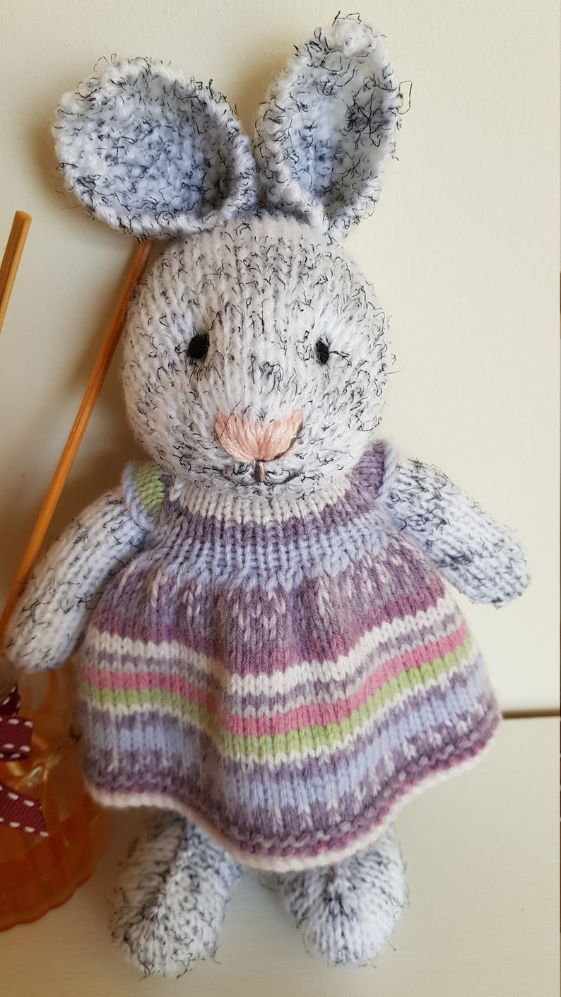 Harriet is eagerly awaiting adoption and can/'t wait to meet her new family Hand knitted bunny Multicolored dress Nursery prop.