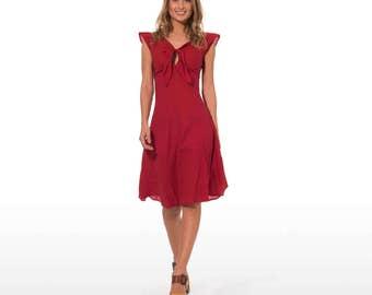 Abito estivo elegante con spalline in puro cotone in tinta unita color  rosso con con nodo frontale 9127049413b