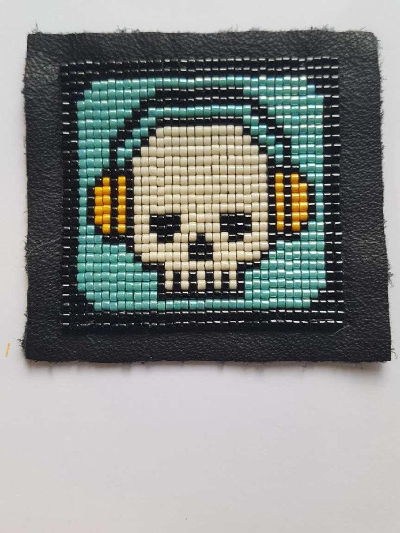 TM Headphones Hand-Beaded Patch by Prison Art Skull