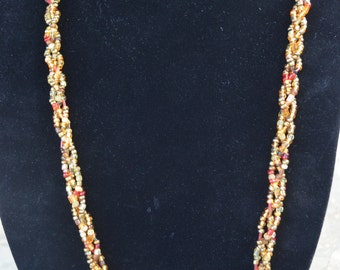 Beautiful handmade necklace made with gold, red, orange, yellow glass seeds