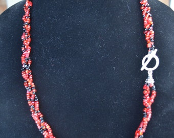 Gorgeous red & black braided glass beads necklace