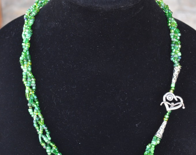 Beautiful braided necklace with green shades of glass seeds