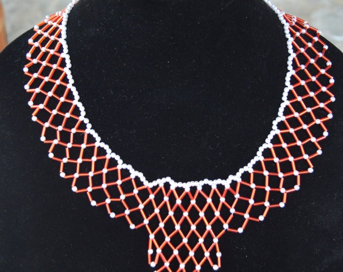Beautiful red and orange necklace with glass bugels and seeds