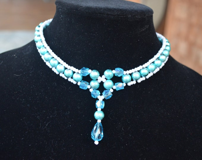 Beautiful necklace made with blue glass beads and seeds