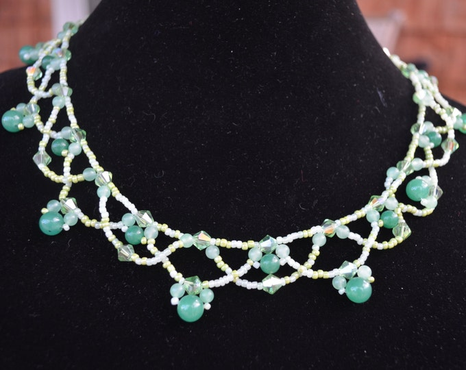 Beautiful handmade necklace made with blue, green and yellow glass seeds