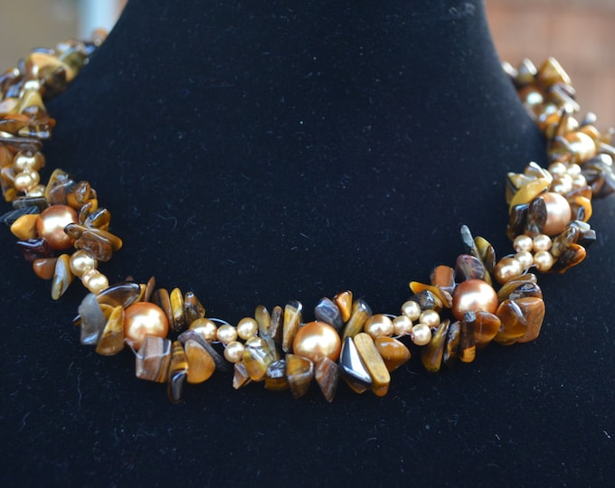 Beautiful handmade necklace made with brown golden beads and rocks