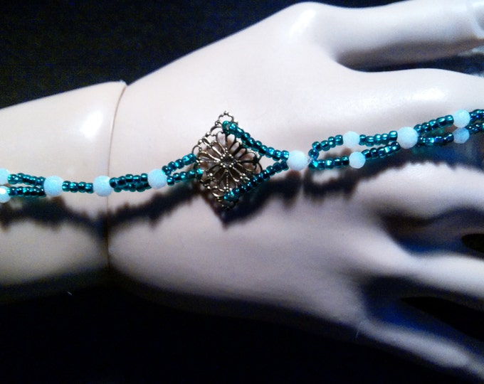Teal Seed, Iridescent White Crystals Roman Slave Bracelet