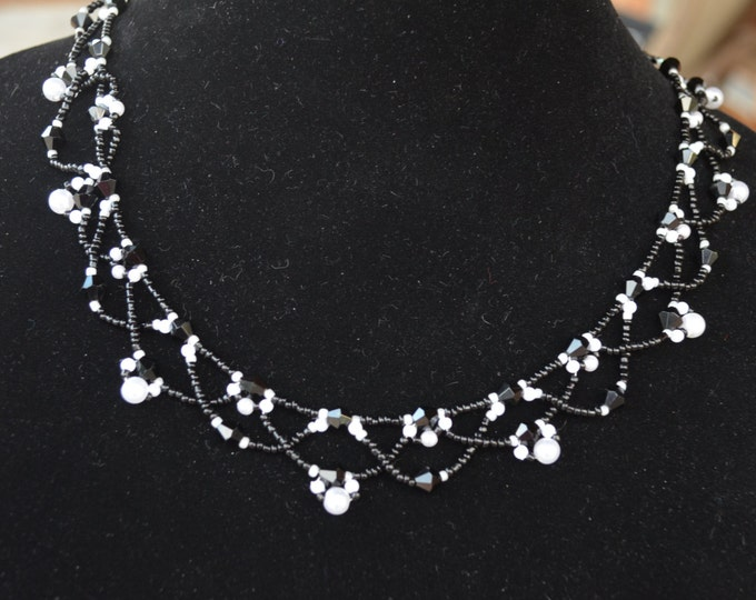 Beautiful handmade black and white pearls and seeds necklace
