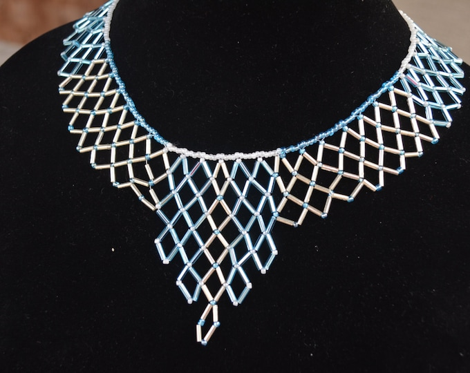 Beautiful handmade necklace made with blue and golden bugel beads and seeds