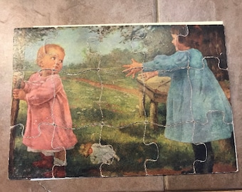Vintage puzzle two little girls in a field playing