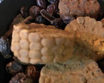 Blackened Wax Corn Cob Nubbins with generous scoop rosehips and cinnamon sticks