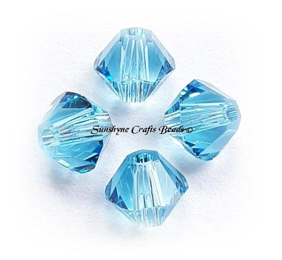 202 8mm Aquamarine blue Genuine Swarovski crystal 5328 XILION Bicone Beads