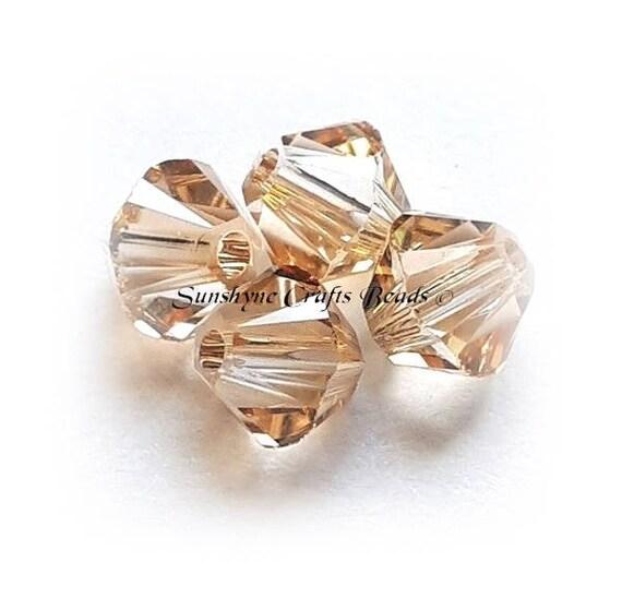6mm Crystal Golden Shadow Genuine Swarovski crystal 5328 XILION Bicone Beads