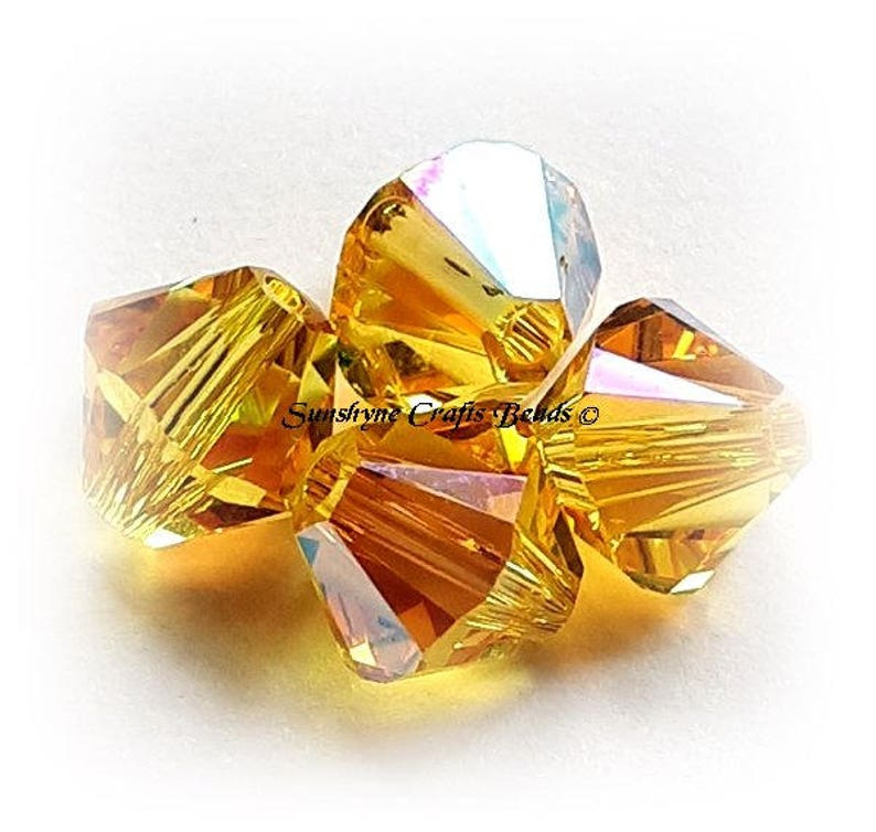 21d916f58d796 Swarovski Crystal Beads 5328 LIGHT TOPAZ SHIMMER Xilion Faceted Bicone  Beads - Sizes 4mm & 6mm available