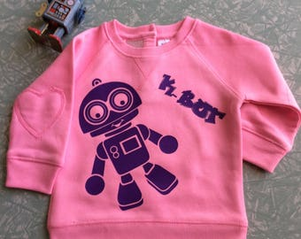 Pink jumper with Kymmy's Corners cute K-Bot robot in purple size 0 6 - 12 months