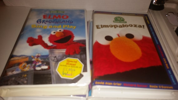 Elmopalooza Elmo Sing And Play Elmo S World Elmo In Groverland Happy Holidays Magic Cookbook Musical Adventure Wild Wild West