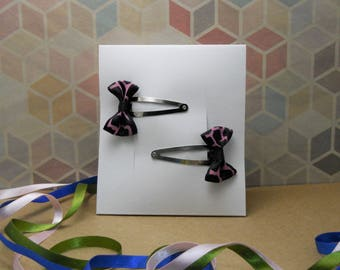 Set of two black bow hair clips