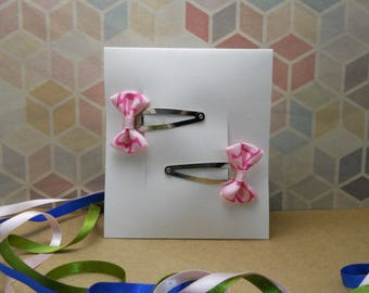 Set of two pink bow hair clips