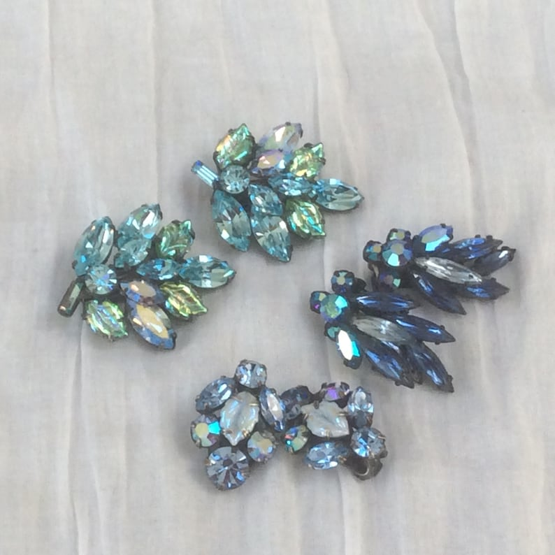 Three pairs Regency style unsigned clip earrings in all shades of blue