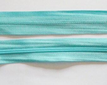 Zipper zips light blue