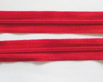 Zipper zips Red