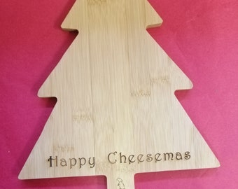 Happy Cheesemas or Merry Cheesemas Engraved on  Quirky Christmas Tree Shaped Cheeseboards.