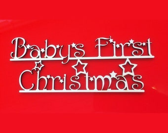 Babys First Christmas Sign With Stars.