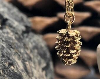mini male pinecone pendant