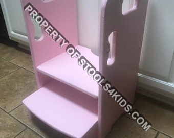 Get up and GO Potty Helper Two-Step Stool. Has  4 handles for ease of use. Sturdy and SAFE, glued and screwed. Fits your toilet! - PINK
