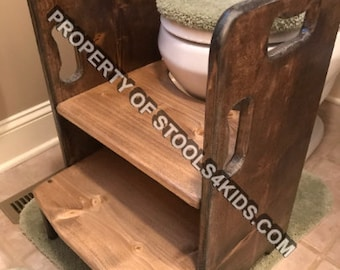 Get up and GO Potty Helper Two-Step Stool. Has handles for ease of use. Sturdy and SAFE, glued and screwed. Dark Walnut and Special Walnut.