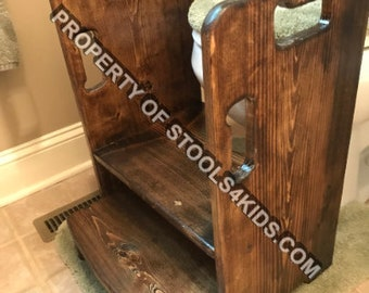 Get up and GO Potty Helper Two-Step Stool. Has 4 handles for ease of use. Sturdy, SAFE, glued and screwed. Fits your toilet! Dark Walnut