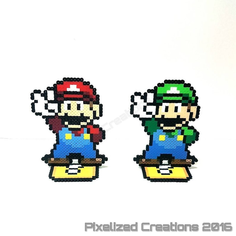 Super Mario World Mario Luigi Figurine Desk Buddies On Question Mark Block Stands Choose From Either Mario Or Luigi Or The Set Of 2