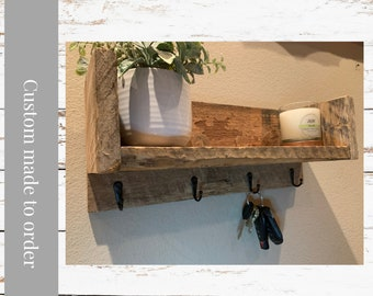 Customize your Barnwood Shelf for either an Entryway Key Hook Shelf, or use as a Bathroom Shelf.  Made from reclaimed barnwood with hooks.