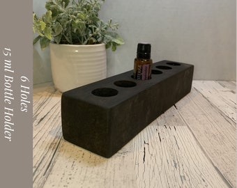 Essential Oil Bottle Holder for 15ml Bottles. Holds 6 Holes, stained charcoal, and natural beeswax finish. Sku: 375