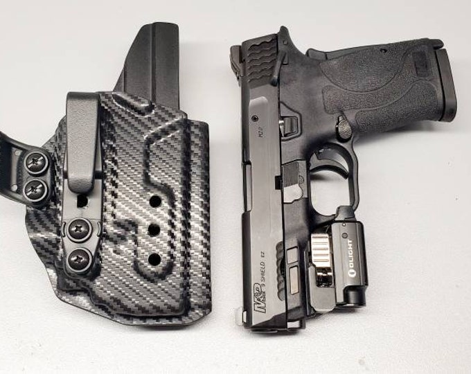 Smith and Wesson M&P Shield EZ 9 with Olight PL Mini 2
