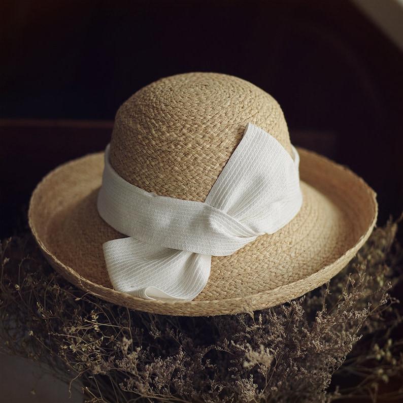 f76bef13b GRAS women's summer straw panama hat with big whit and brown bow tie wide  hooded brim straw hat gardening hat vintage beach hat sun hat