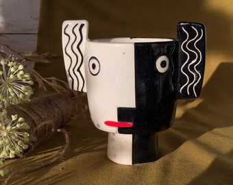 Character handmade ceramic plant pot with two faces and wavy ears