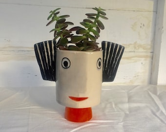 Small ceramic stoneware plant pot with faces and big stripes ears