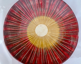 Red sunray striped hand built and painted  ceramic serving dish or fruit bowl. Small flaw so half price