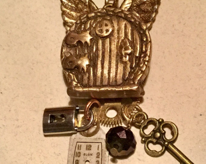 B63   STEAMPUNK Pendant, handmade fairy door, pure bronze, watch parts, fairy wings, dangling key/lock/gem/watchface, braided black cord