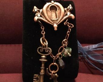 B235 Large Steampunk bronze piece, handmade, key hole, antique key, original, silk cord, gem, dove