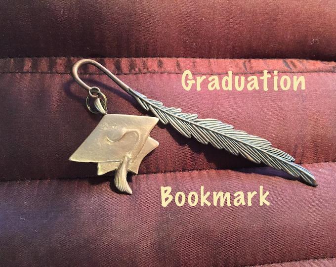 B152 Graduation bookmark, Bronze handmade bookmark on a feather shank