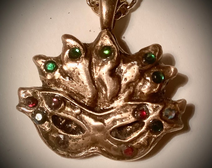 11/19/2. Mardi Gras Mask made in pure rose bronze, all handmade, on a handmade bronze chain,  11 real gems that are all cubic zirconium